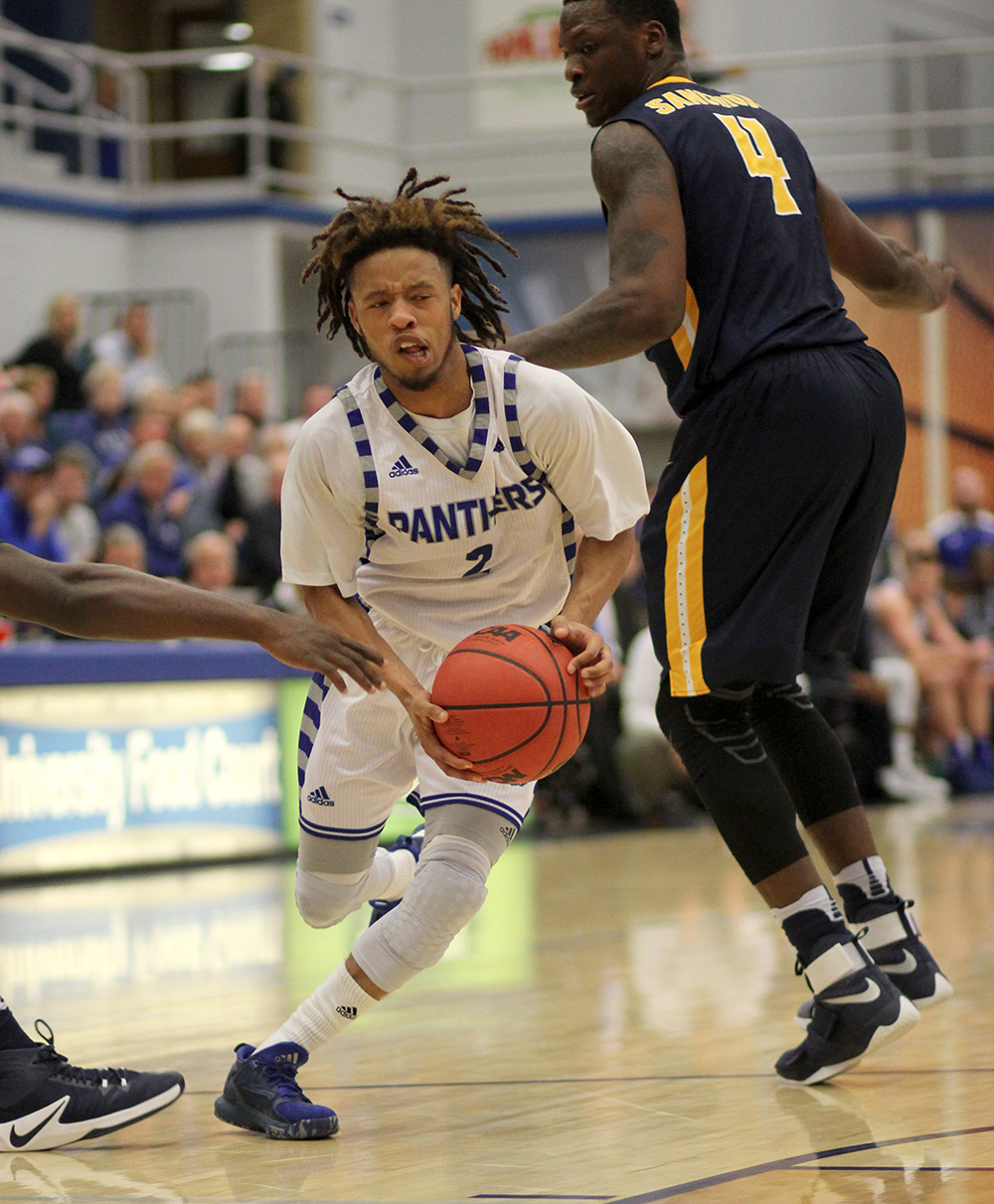 Junior Terrell Lewis drives past two Murray State defenders in the first half on the Panthers' 83-72 loss to the visiting Murray State Racers.