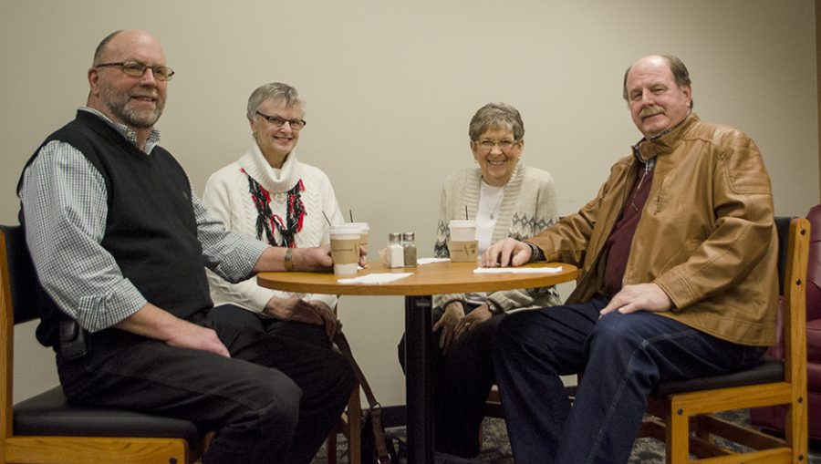 Zane Shelton, left, Jan Shelton, second from left, Annie Aschenbrenner, second from right and Mike Shelton, right pose for a photo Wednesday afternoon in the cafe located in Klehm Hall. The group is sitting on one of the new tables donated by Mike Shelton in memory of his wife Linda Shelton.
