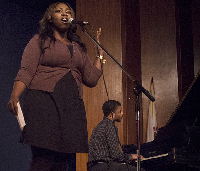 Jenel Murray, a community member and former Eastern student, sings the Black National Anthem during the Martin Luther King Jr. ceremony in the Grand Ballroom of the Martin Luther King Jr. University Union.