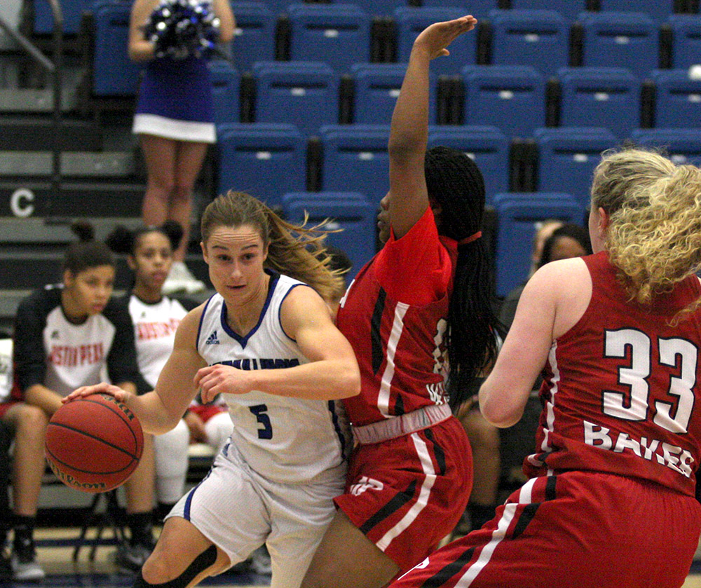 Junior Grace Lennox drives at the basket against an Austin Peay defender Saturday at Lantz Arena. Lennox led all scorers with 22 points in the Panthers' 69-59 loss to the OVC conference opponent.