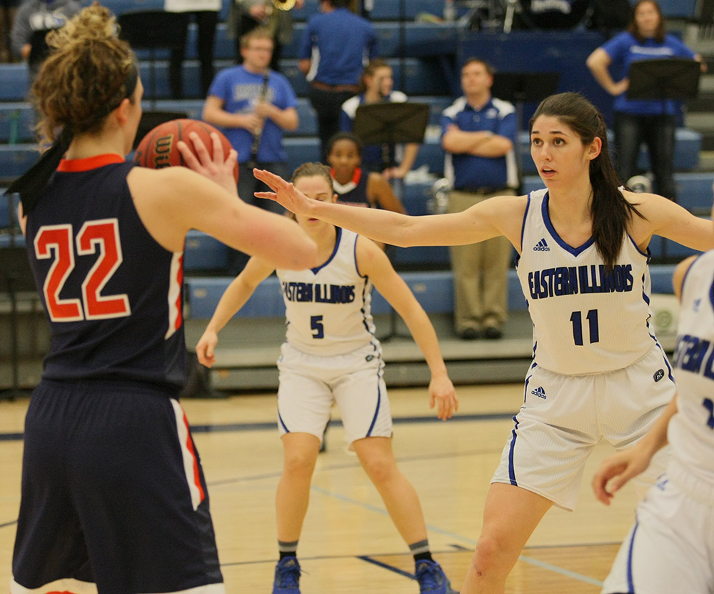 Senior forward Erica Brown defends a pass from Tennessee-Martin's Ashton Feldhaus Wednesday at Lantz Arena. Brown scored 13 points  and added 5 blocks in the Panthers' 80-70 overtime win.