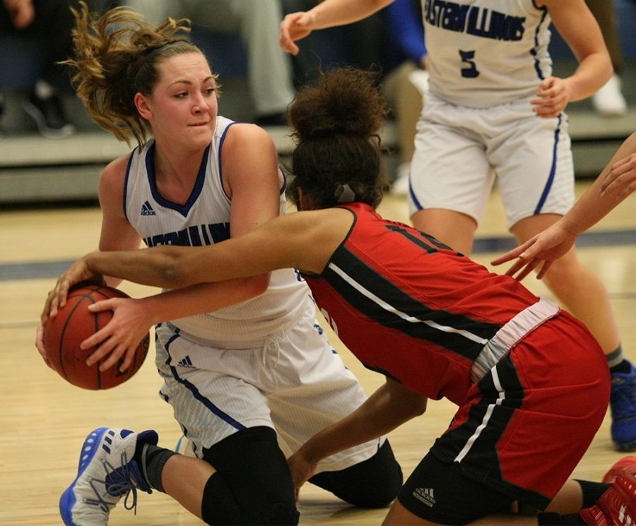 Bryan Bund | The Daily Eastern News Freshman Allison Van Dyle wrestles for the ball against a SIUE defender.