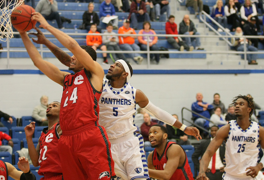 Junior Ray Crossland tries to stop SIUE's Henry Jailen from converting a layup Saturday at Lantz Arena. Crossland scored 19 points and added 10 rebounds in Eastern's 75-60 win.