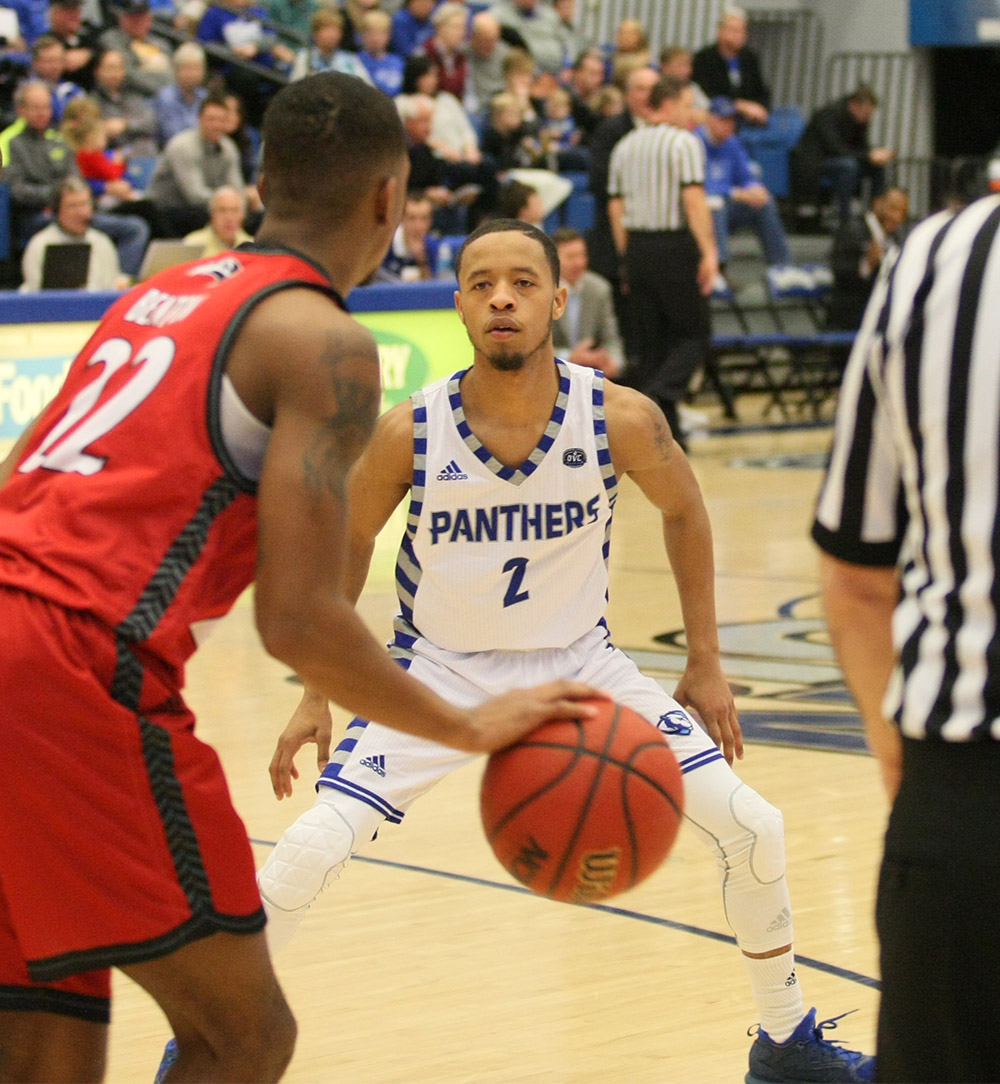 Junior Terrell Lewis tries to defend from SIUE's Justin Benton Saturday at Lantz Arena. Lewis knocked down 8-of-12 3-pointers for 24 points and panthers 75-60 win.