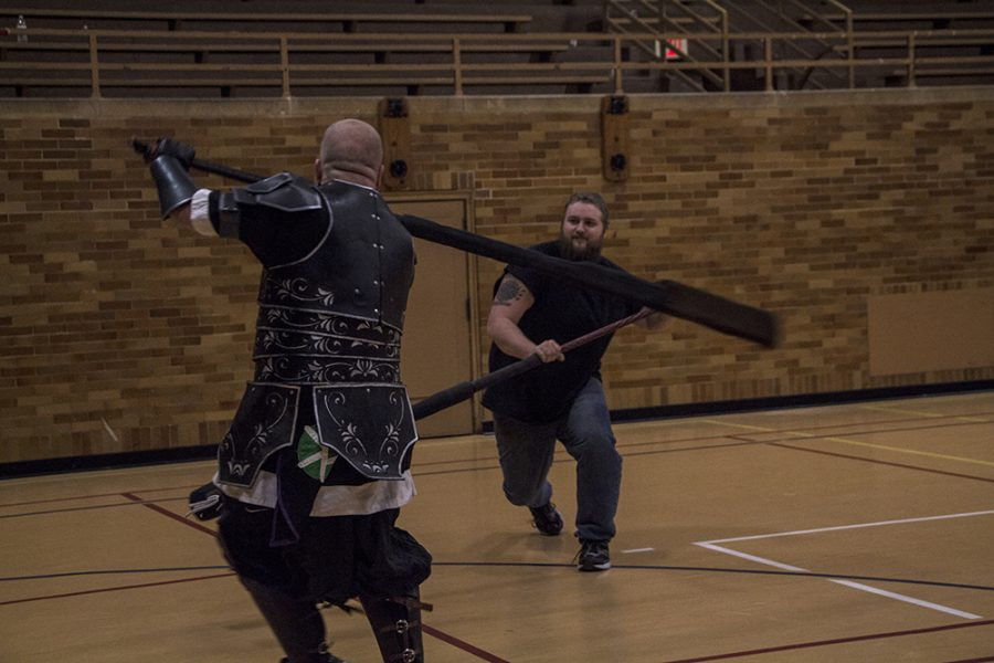 "Camelia Nicholson | The Daily Eastern News Alex McCune, known as Mudd, from England practices larping with Mikel Welton, a sophmore applied engineering major in the Mcafee gym on monday afternoon. ""It's a fun way to relieve anger and stress"" says Welton."
