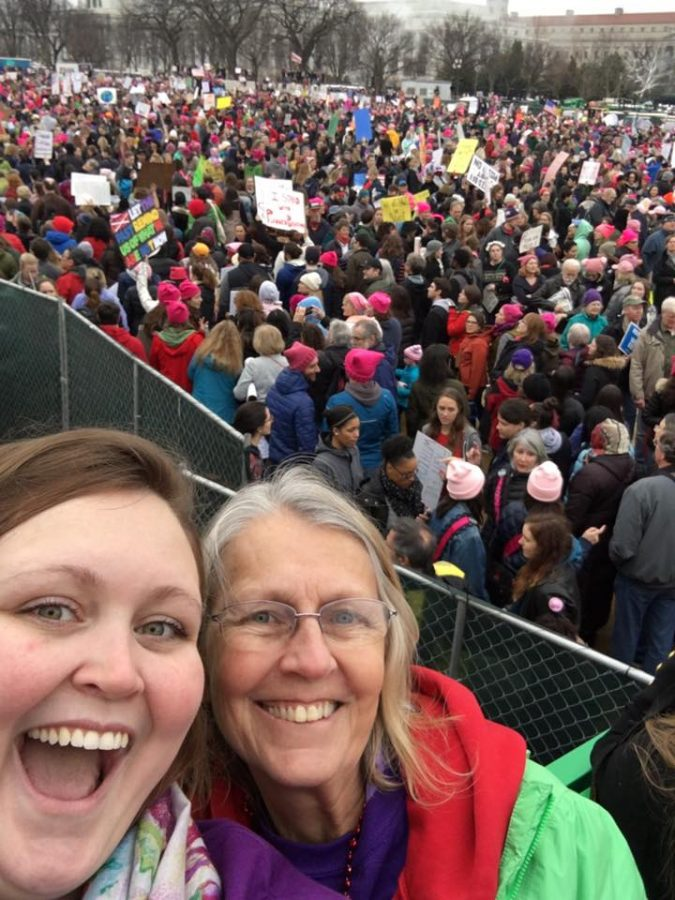 Meagan Ramey, a senior biological sciences major, poses with her mother, Stephanie Adams, 62, of Middleton, Wis., at the Womens March in Washington, D.C. Saturday.