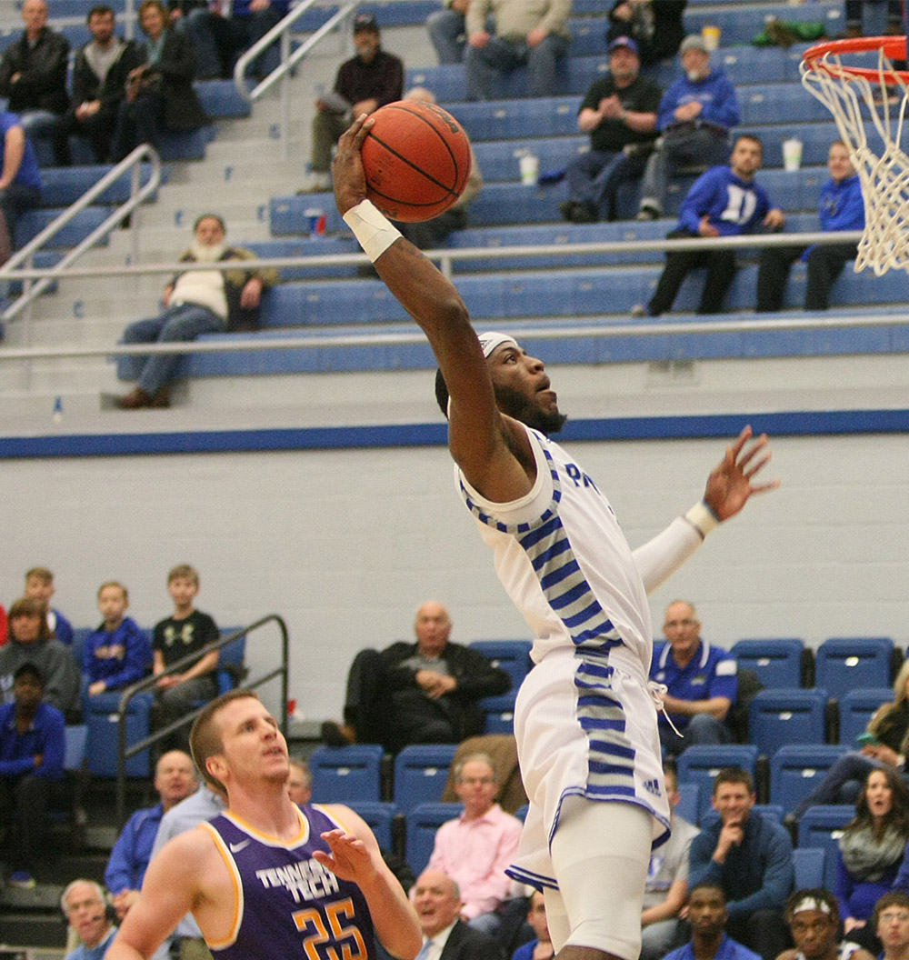 Junior Ray Crossland prepares to slam one home Saturday at Lantz Arena.