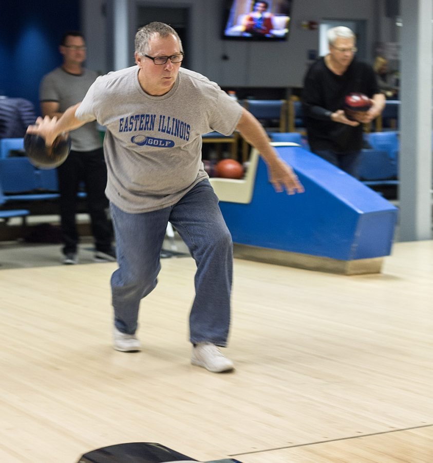 Jim+Stone%2C+a+Charleston+resident+and+Eastern+building+service+worker+warms+up+before+the+Monday+night+faculty%2Fstaff+league+in+the+EIU+Bowling+Lanes.+Stone+is+a+member+of+team+%E2%80%9CAchemists%E2%80%9D+and+is+in+his+third+year+in+the+league.+The+league+competes+every+monday+and+runs+from+Sept.+to+April.+Each+team+consists+of+4-man+teams+with+substitutions+welcome.