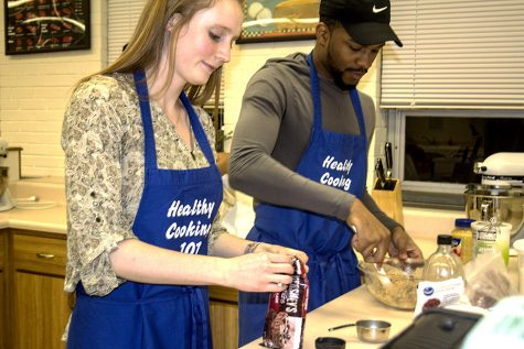 Liz Kunkel, a nutrition and dietetics graduate student and Dhiaa Dean, a health promotion leadership graduate student make dark chocolate cranberry oatmeal cookies for a healthy cooking 101 class which is offered as part of heart health awareness month in Klehm hall on Tuesday.