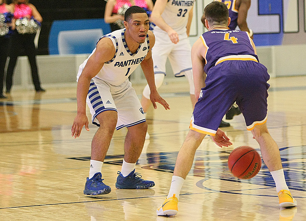 Senior guard Demetrius McReynolds defends the dribble of Tennessee Tech guard Aleksa Jugovic during Saturday's OVC game at Lantz Arena. McReynolds scored 10 points for the Panthers in an 87-68 loss.