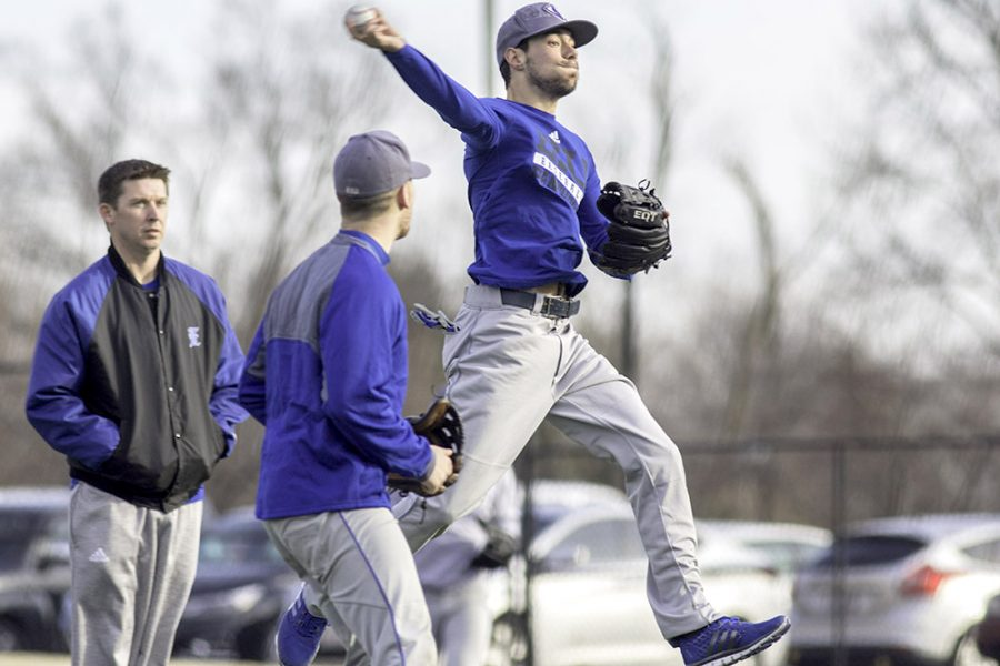 Sophomore%2C+Dane+Toppel%2C+throws+to+first+base+while+teammate+Andrew+Curran+and+head+coach+Jason+Anderson+watch+during+a+scrimmage+on+O%E2%80%99Brien+Field+Monday+afternoon.+The+Panthers+open+the+season+Friday+at+the+University+of+South+Alabama.