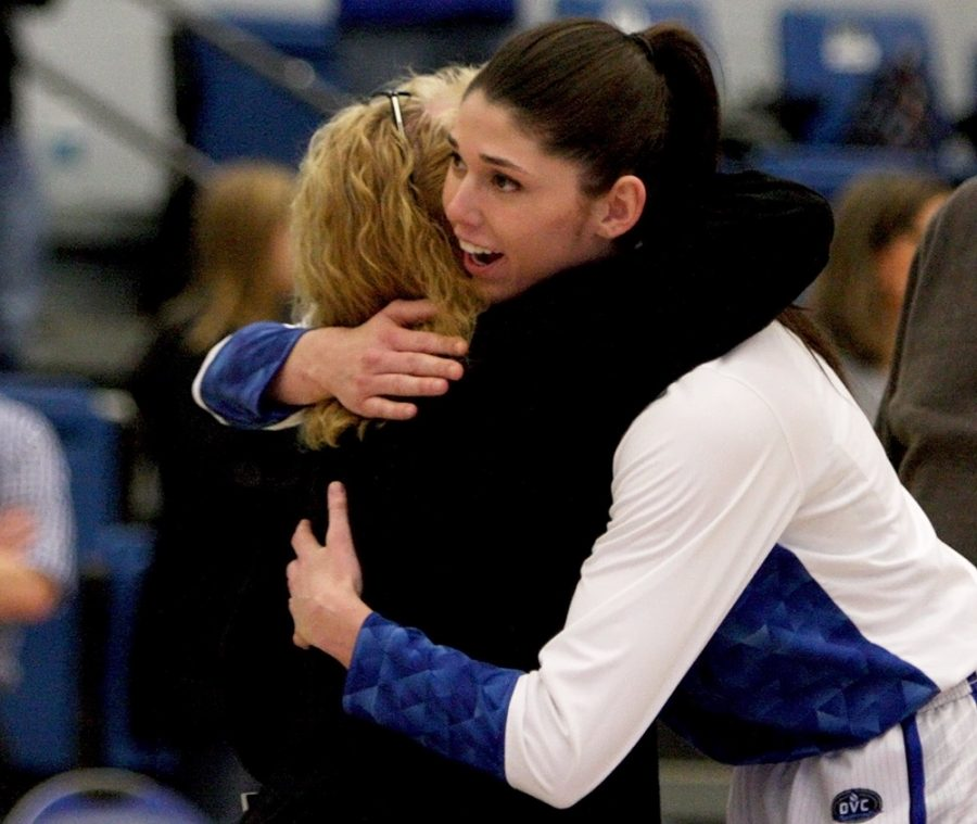 Senior+Erica+Brown+hugs+coach+Debbie+Black+prior+to+her+final+game+in+Lantz+Arena.+Brown+is+Black%27s+first+player+to+play+four+years+with+her+and+graduate.