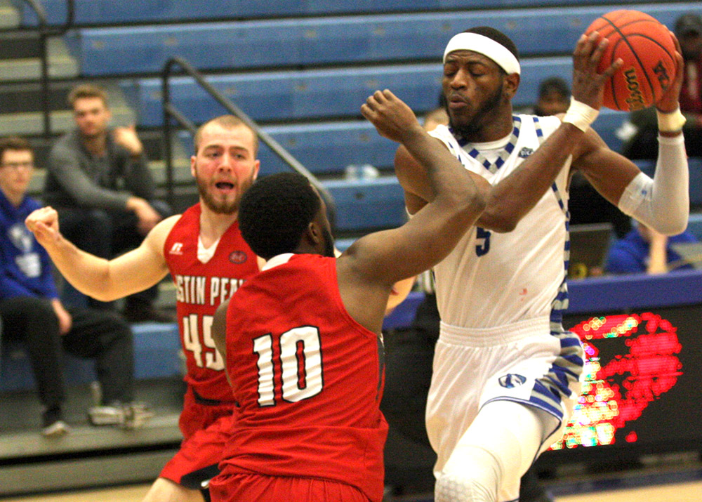 Ray Crossland makes a move to the basket against the Austin Peay defenders Saturday, Jan. 14 at Lantz Arena. He ended up with 6 points in the lose to the Governors.