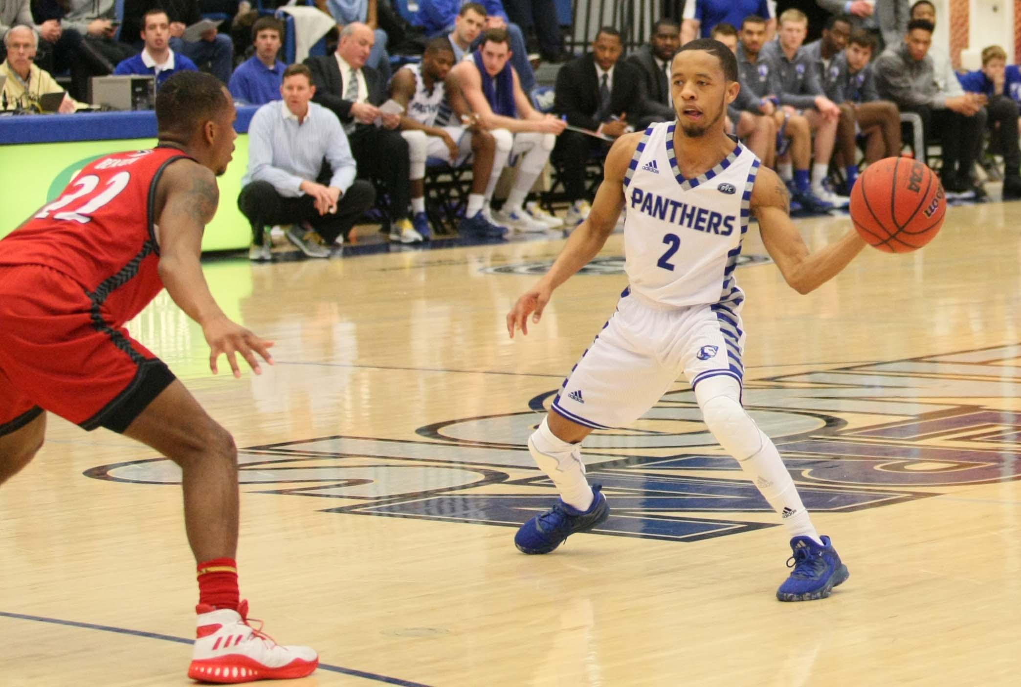 Junior guard Terrell Lewis passes to an open teammate Saturday, Jan. 28 at Lantz Arena. The Panthers defeated the visiting Cougars 75-60.