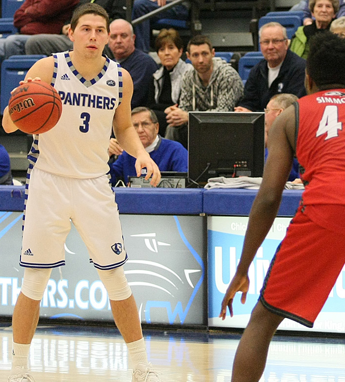 Sophomore+guard+Casey+Teson+sets+the+offense+Saturday%2C+Jan.+28+at+Lantz+Arena.+The+Panthers+defeated+the+Cougars+75-60.
