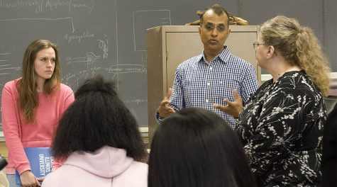 Dr. Britto Nathan, biological science professor, shows admitted students his lab in the Life Sciences building Monday morning. Nathan explains how he does experiments with students and typically examines the brain. Parents and students were given a chance to ask about Nathan's research experience with Alzheimer's disease.