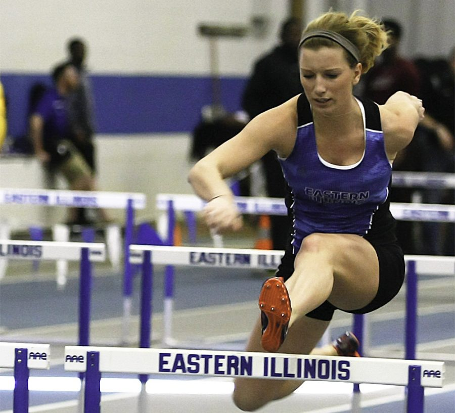 Senior+Tori+Master+clears+a+hurdle+Friday+during+the+Friday+Night+Special+at+Lantz+Fieldhouse.+Master+earned+a+first+place+finish+in+the+400-meter+hurdle+with+a+time+of+1%3A06.34.