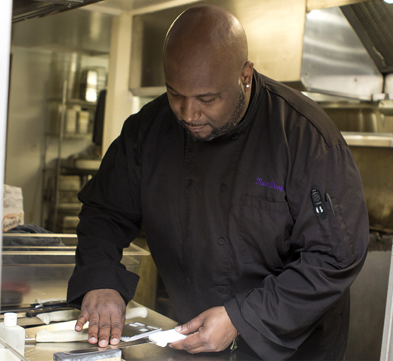 Chef Nate Douglas sharpens his knives in preparation of the anticipated early March opening of Alexander Briggs.
