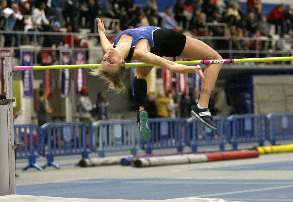 """Junior Haleigh Knapp clears the height of 5'11"""" 1/4 inches. This jump won Knapp the meet as well as setting a facility and conference record. """"I was real happy with it because I have been having a rough season but I knew what I needed to do for my team."""" Knapp said after the jump."""