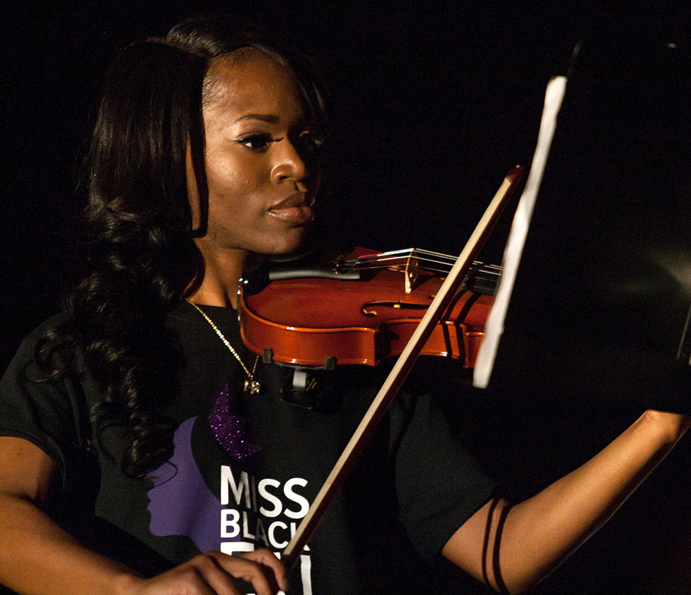Senior Fudia Jalloh plays the violin during the talent section of the Miss Black EIU Scholarship Pageant Saturday, March 25.