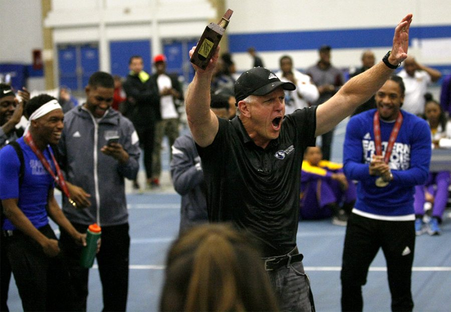 Head coach Tom Akers celebrates after the announcement that both the men's and women's track teams both won the OVC championship following Saturday's final day of the conference meet.