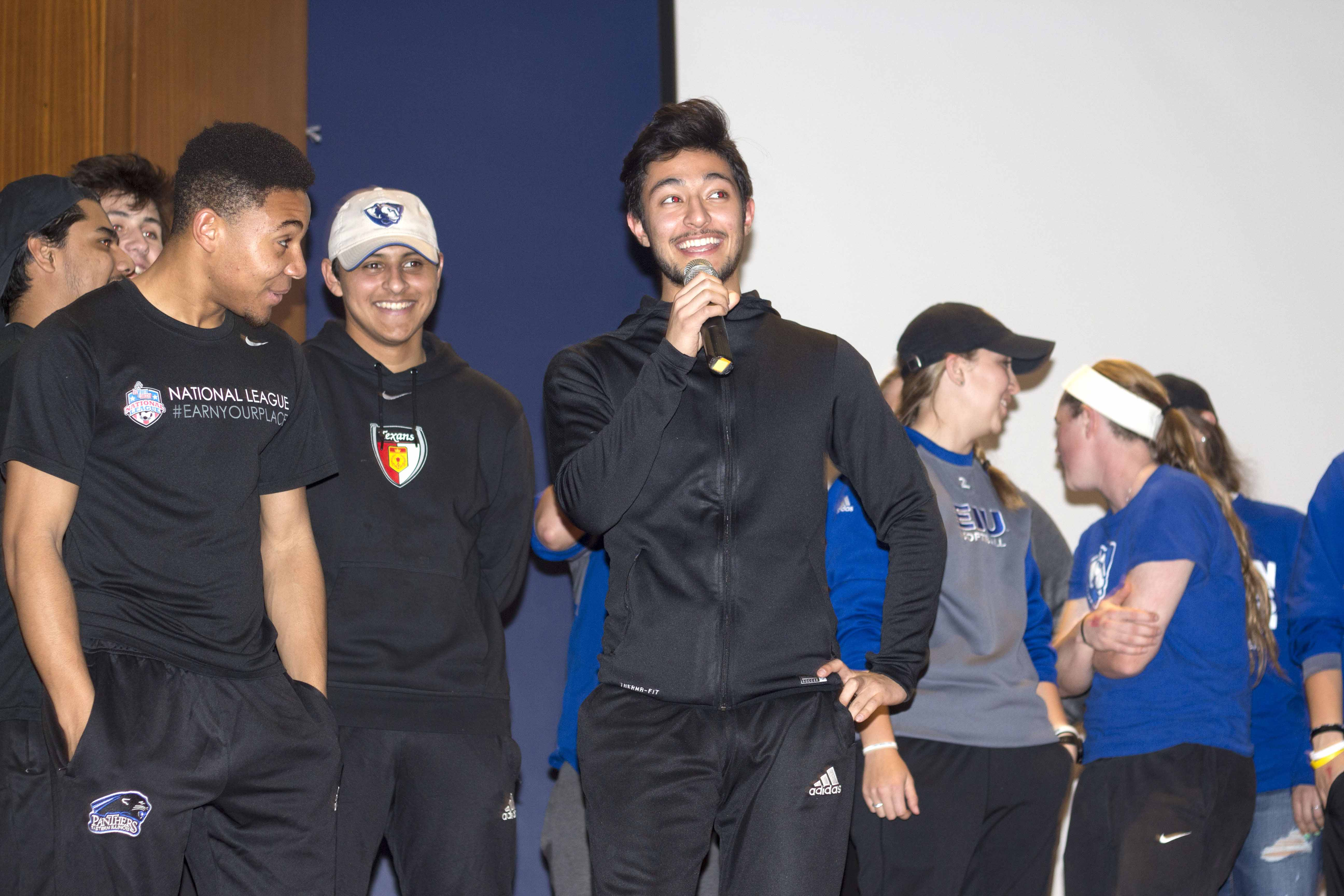 Andre Nappa, a freshman psychology major gives a quick acceptance speech on behalf of the men's soccer team, who were the winners of Jock 'n' Roll which featured skits from members of sports teams at EIU.