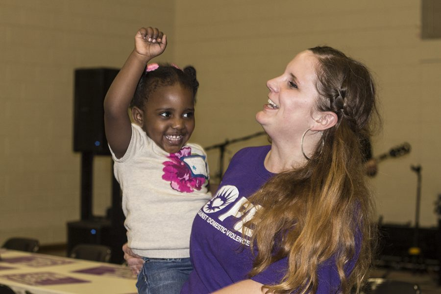 Dee Maddr, dances with Kandence Newsome, the daughter of Ky Newsome, a member of hope during Bowls of Hope, a fundraiser for The Hope foundation which featured live music, a dessert auction, and soup.