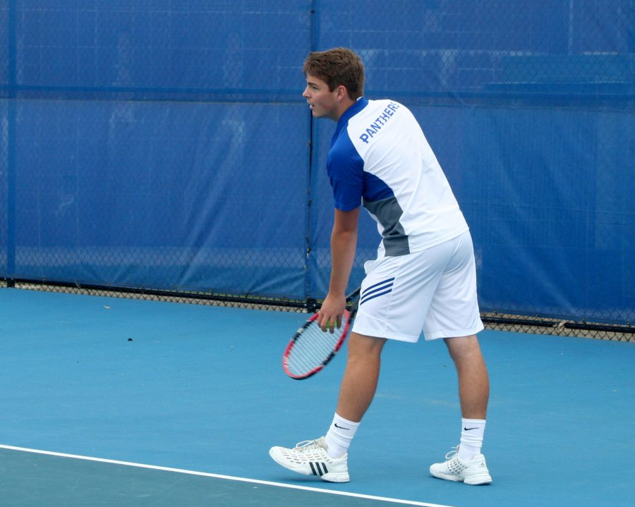 File+Photo%7C+The+Daily+Eastern+News%0AFreshman+Ferdinand+Ammer+prepares+to+serve+the+ball+in+the+Eastern+tennis%27+program%27s+alumni+match+in+the+fall+on+the+Darling+Courts.
