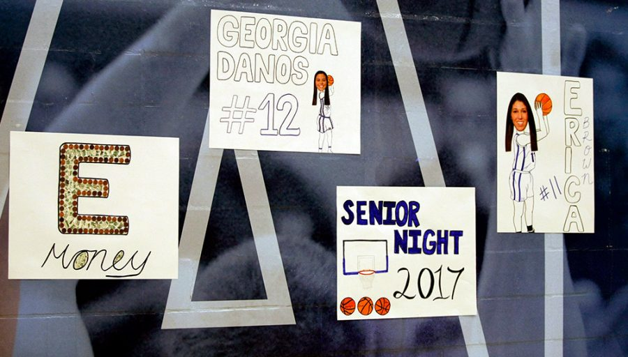 Signs+were+hung+to+honor+the+three+seniors+on+their+final+night+playing+at+Lantz+Arena.