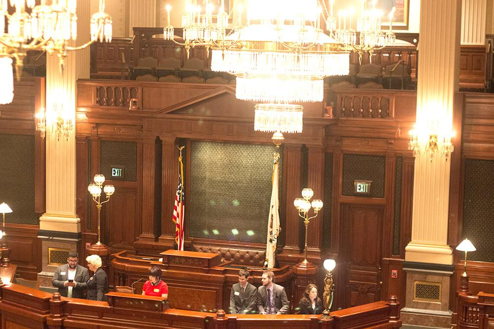 Model Illinois Government Students act as members of congress as they debate a mock case regarding immigration in The Illinois State Capitol House Chamber.