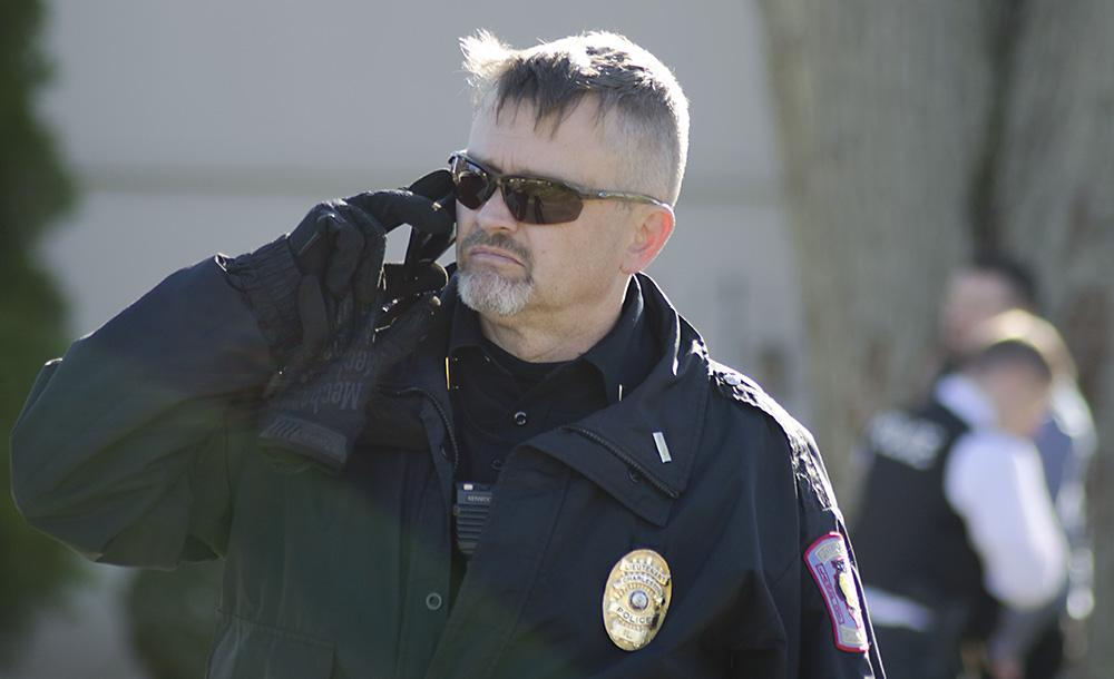 Charleston patrol lieutenant John Bennet talks on his cell phone after the police executed a search warrant Tuesday at 973 Arthur Ave.