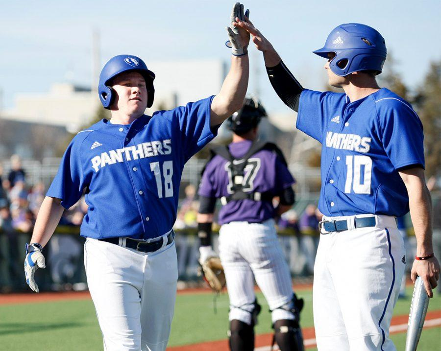 Junior+Logan+Beaman+%2818%29+high-fives+teammate+Joseph+Duncan+during+a+game+Saturday%2C+March+4+at+Tointon+Family+Stadium+in+Manhattan%2C+Kan.+The+Panthers+picked+up+their+second+win+of+the+season+Friday+in+a+7-5+victory+over+Jacksonville+State.