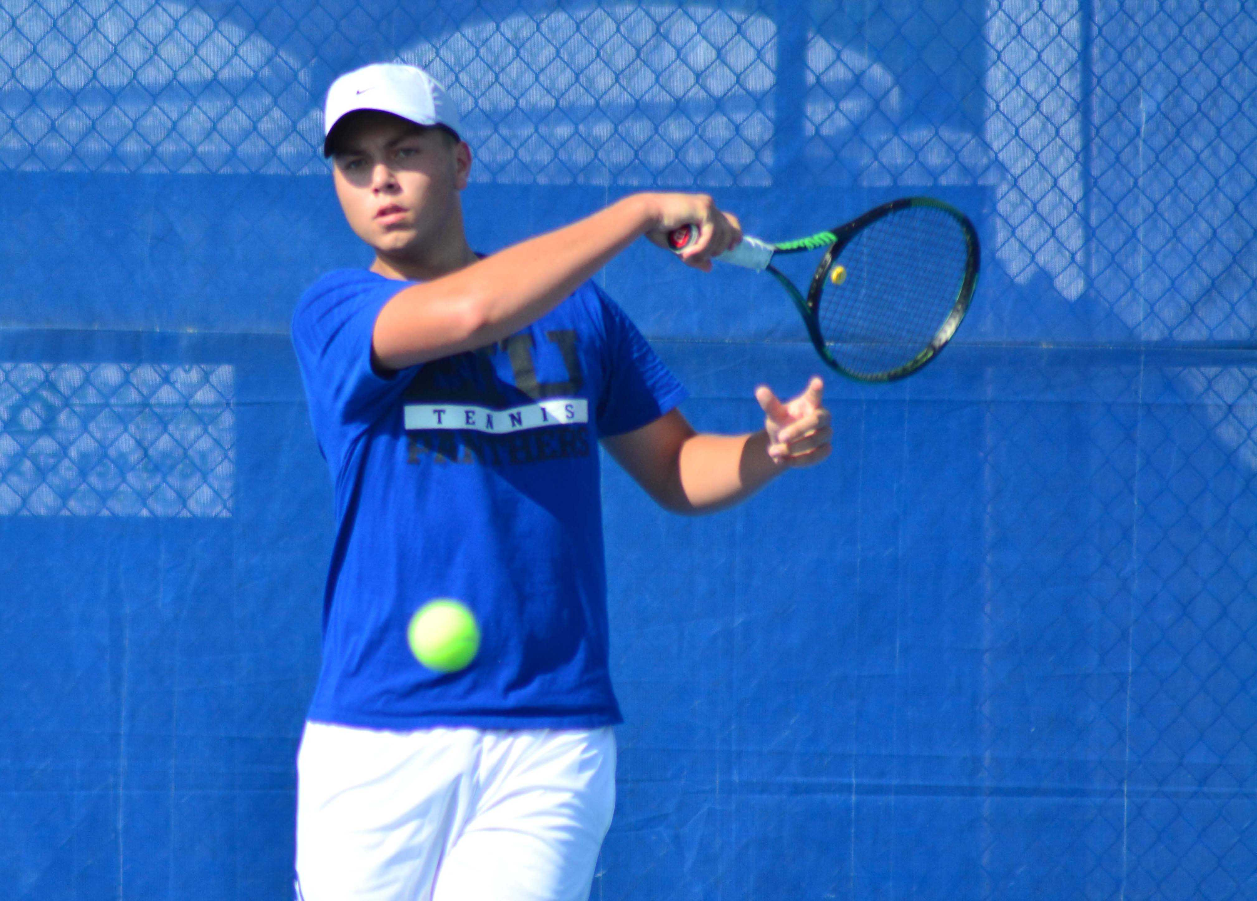 Freshman Gage Kingsmith returns a serve during a practice Tuesday, Sept. 6. Kingsmith currently sports a 1-13 individual record and 5-9 in doubles play with different teammates.