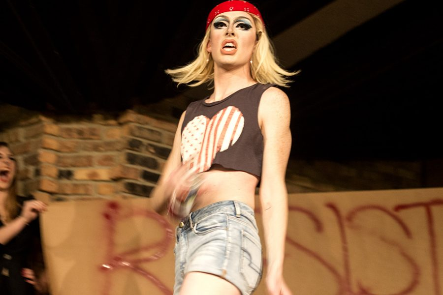 Lady+Save+the+Bees+models+in+front+of+her+Resist+poster%2C+in+which+she+spray+painted+as+part+of+%0AThe+Diva+Drag+Show.