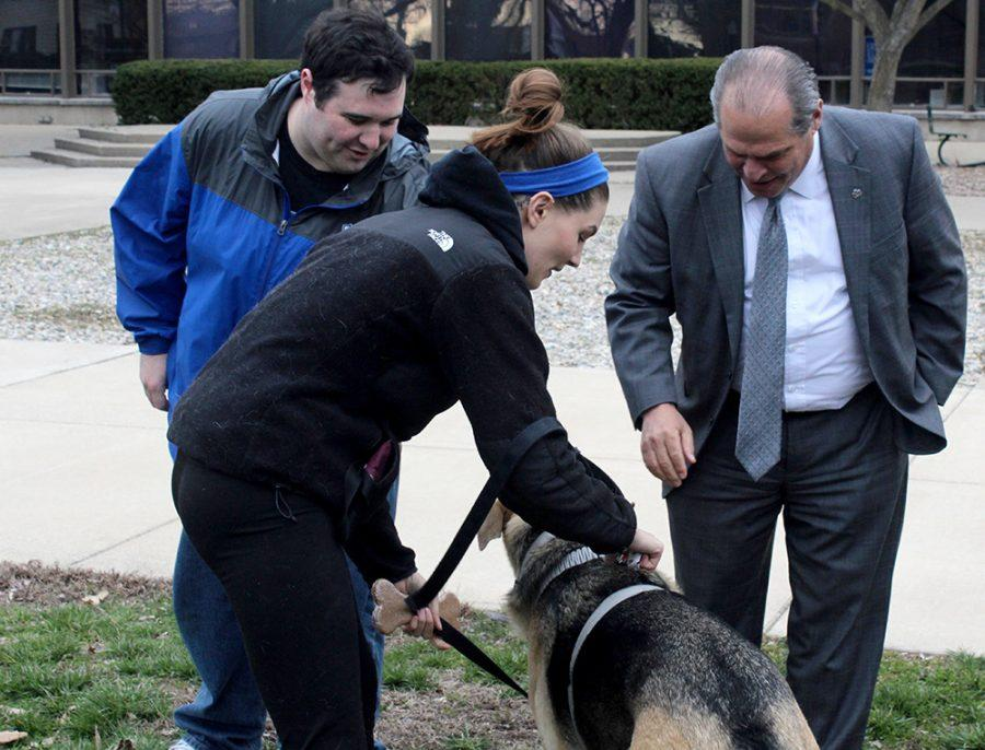 Eastern+President+David+Glassman+pets+Koda%2C+a+2-year-old+German+Shepard+Thurdsday+in+the+Library+Quad+during+Prowlin+with+the+Pets.+Student+Government+hosted+the+event+to+give+students+the+opportunity+to+show+off+their+pets%2C+talk+with+President+Glassman%2C+and+have+a+fun+time+with+the+animals.