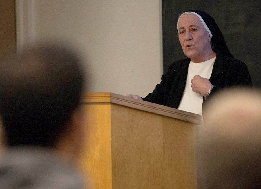 Sister Habiba Bihnam speaks to an audience during Wednesday's Panel on Refugees in Coleman Auditorium. The Iraqi-Dominican sister is currently living and working in Springfield until September when she will return to Iraq.