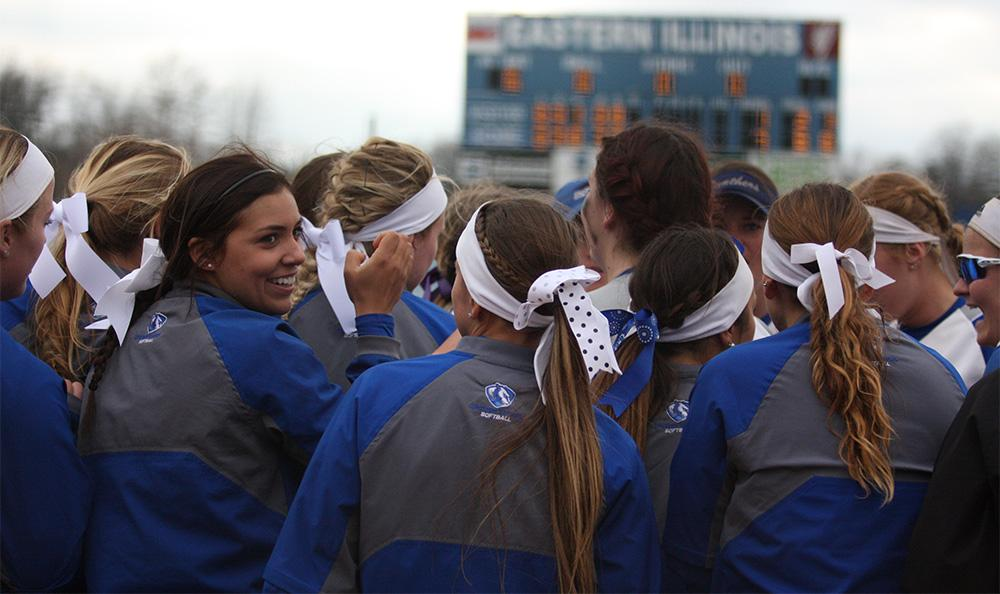 The Eastern softball team huddles up at the end of the top of the sixth inning in Sunday's win over Tennessee State in the second game.