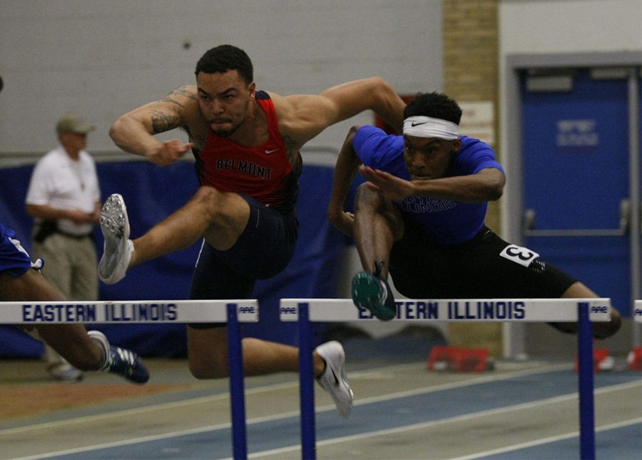Senior John Piper goes over the hurdles in the 60 yard hurdles. Piper won the race in a time of 8.07 setting a new personal best.