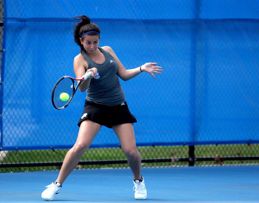 Junior Maria Mosteva sends the ball back to her EKU opponent in her singles match March 24 at the Darling Courts.