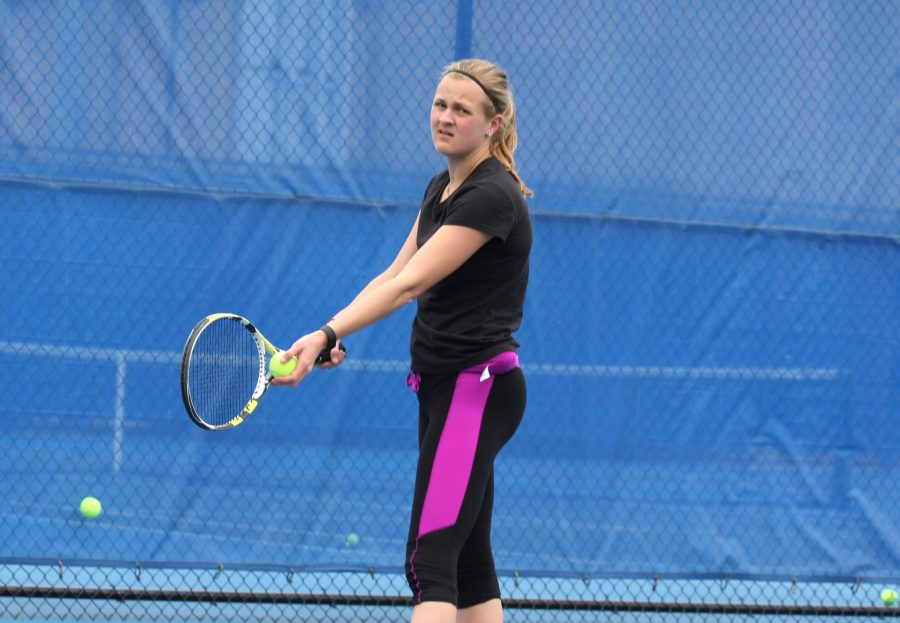 Senior Kelly Iden prepares to serve the ball in practice in the spring of 2016. Iden continued to find success in the No. 1 spot after defeating her opponent in singles and also winning in her doubles match.