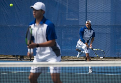 Junior Grant Reiman serves during his doubles match with freshman Gage Kingsmith April 8, 2017, at the Darling Courts. Reiman and Kingsmith were defeated by their Austin Peay opponents 6-4.
