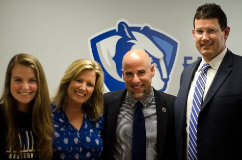 Women's basketball coach Matt Bollant, second from right, Athletic Director Tom Michael and Bollant's wife Kari and daughter Regan pose for a photo after Monday's introduction of the new coach.