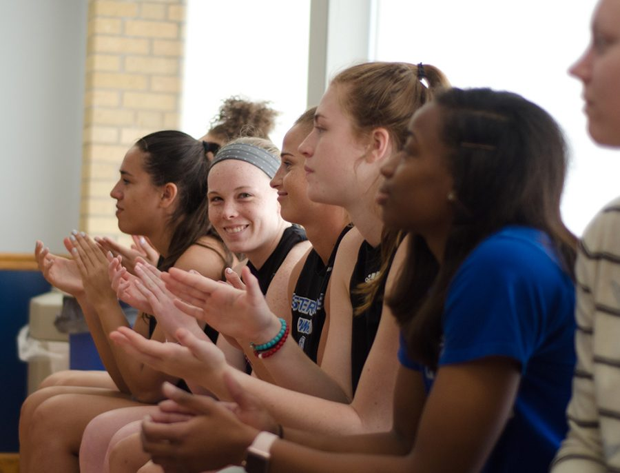 Members of the women's basketball team cheer during the announcement of their new coach Matt Bollant Monday afternoon in Lantz Arena.
