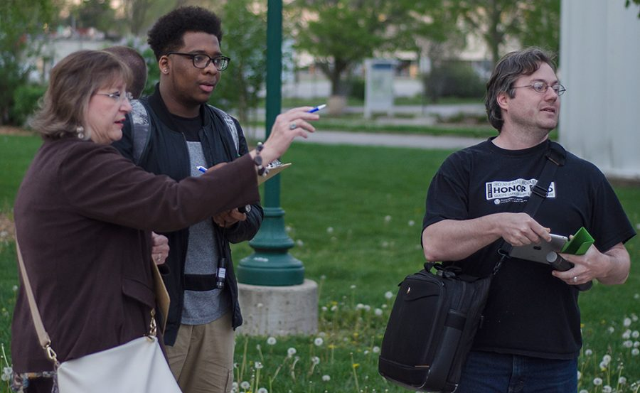 Lynette Drake, interim vice president for student affairs points out areas of concern to sophomore Tarvea Durant, center, chair of the University Enhancement committee and graduate student Ryan Siegel Monday during the Safety Walk hosted by Student Senate.