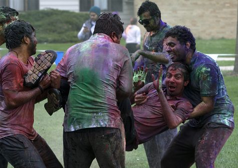 Kishore Bandarupalli, graduate student in the school of technology is carried by a group of friends Saturday at the HOLI event in the Library Quad.