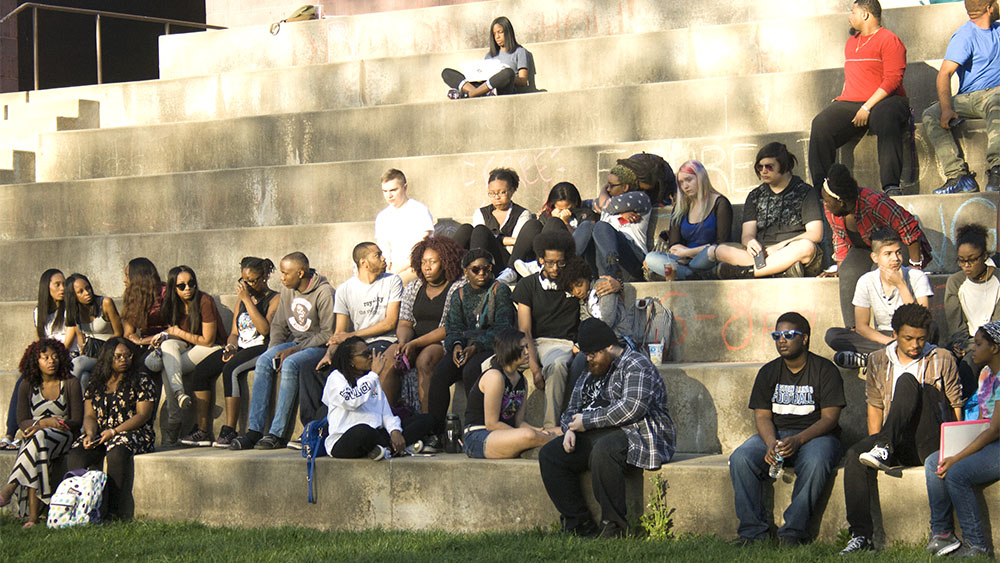Students console one another after a moment of silence was held for Byron Edingburg, the Eastern Illinois student that was killed in a shooting over the weekend.