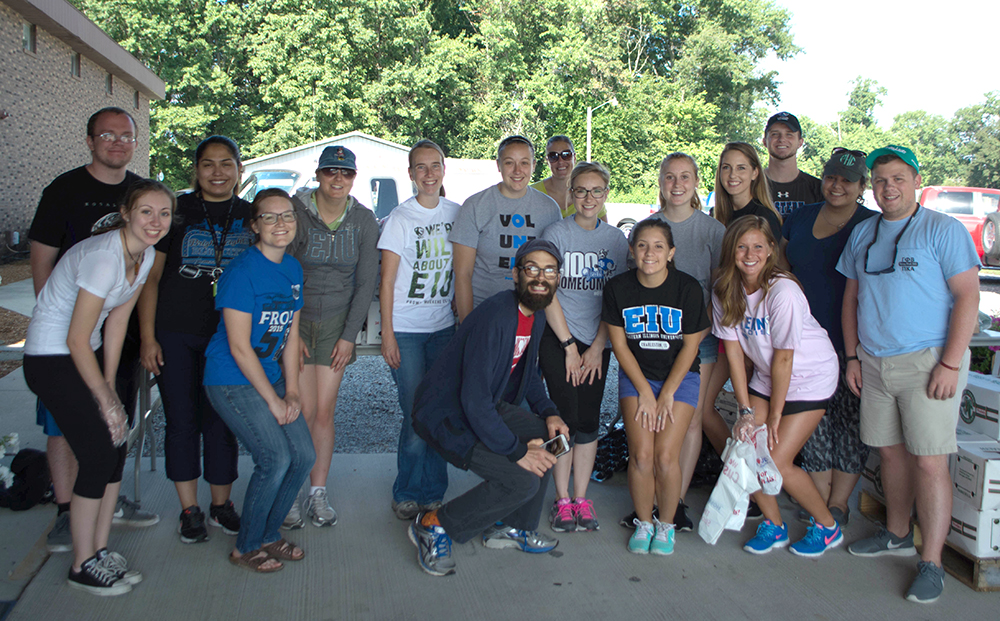 Volunteers at the Toldeo mobile foodpantry take a break for a group photo Saturday, Aug. 27.