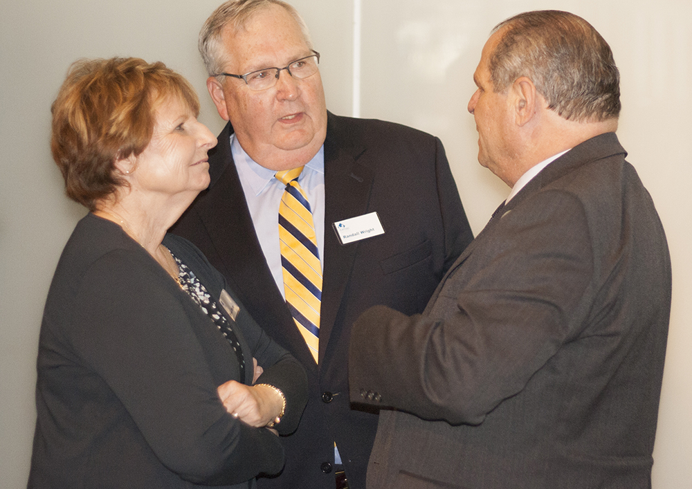 """Randall and Brenda Wright talk with Eastern President David Glassman following the presentation of the 2107 Burnham and Nancy Neal Outstanding Philanthropist Awards at the Doudna Fine Arts Center Friday.  Randall Wright, a Charleston native, said in addition to all of his relatives who attended Eastern, about half of them had also worked at the university.  His mother worked in the former housekeeping department and his father oversaw the university post office, he said. """"Eastern means a lot to our family overall… in terms of providing education to move us forward and as way to provide for families on a daily basis,"""" Wright said."""