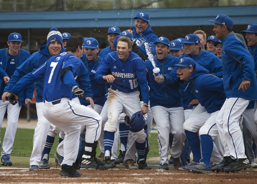 The baseball team celebrates with Hunter Beetley (7) after his walk-off two-run home run in the bottom of the 11th inning during the Panthers' first game of a three-game series against Eastern Kentucky Saturday at Coaches Stadium. The Panthers' won the first game 13-11.