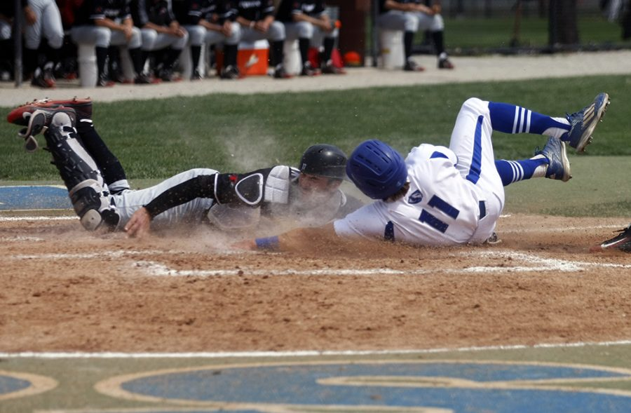 Sophomore Jimmy Govern slides safely into home plate after a wild pitch in the 2nd inning.